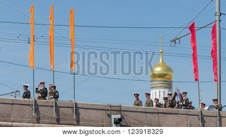 Moscow - 7 May 2015: Many soldiers and officers in stylized military uniform flow along the Great Moscow River bridge on the background of the bell tower of Ivan the Great dome at the rehearsal of the military parade May 7 2015 Moscow Russia