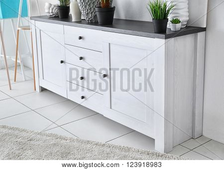 White commode on light wall background