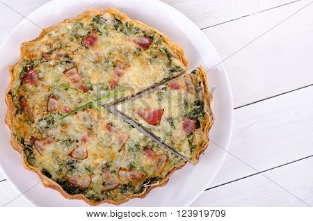 A piece of French quiche Lorraine top view