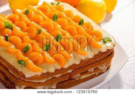 Cake citrus pie decorated with mandarin and mint