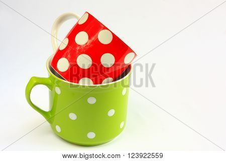 Red and green cup with white polka dots