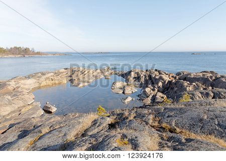 Coast cliffs islet and ocean a sunny day during spring time in scandinavia