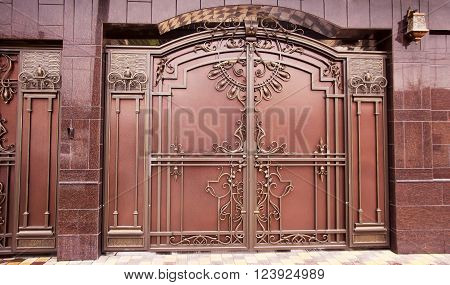 ornate metal gates in the design of granite