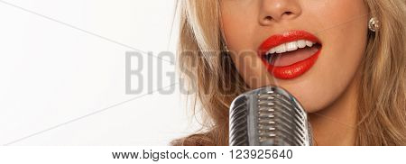 sexy singer lips with retro microphone on white