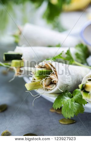 Vegan rolls made of daikon and sprouts ** Note: Shallow depth of field