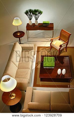 photo in the room studio room sofa, carpet, chair, lampshade and decorative pieces
