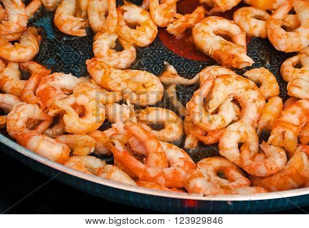 shrimps fried on a griddle, roasting fresh, flavorful shrimp