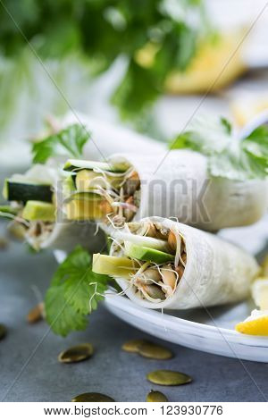 Healthy daikon rolls stuffed with sprouted grains ** Note: Shallow depth of field