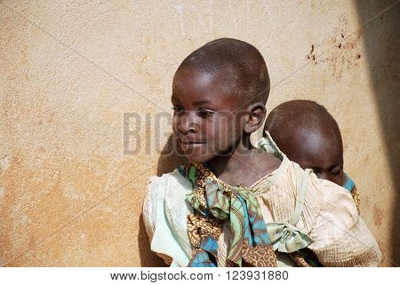 August 8 2015 Pomerini-Tanzania-Africa-Two unidentified African children normally are older children to look after smaller ones neglected by parents often sick or dead of AIDS or tuberculosis