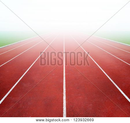 Running track with bright light in distance