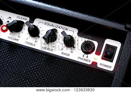 Black guitar music amplifier close-up. Musical equipment.