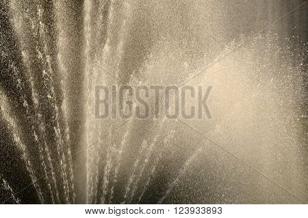 Beautiful Fountain sprays with water drops in the air. Fountain in Riga canal. Sepia tinted.