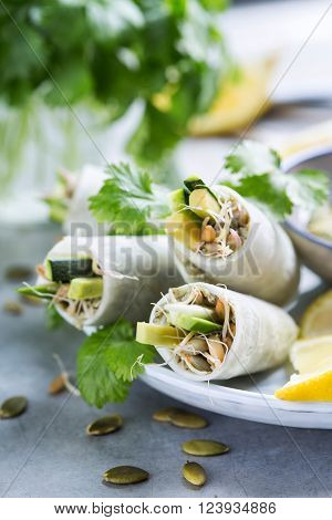 Close up of vegan daikon rolls with avocado and sprouts ** Note: Shallow depth of field