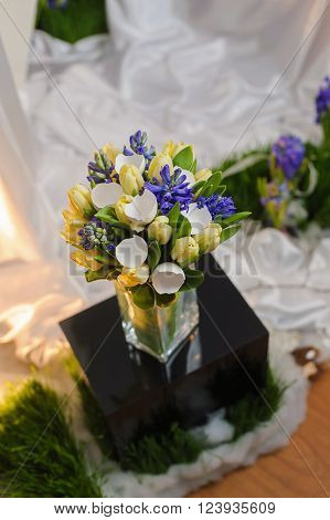 Unusual bouquet of tulips with eggshell. Bouquet in a vase.