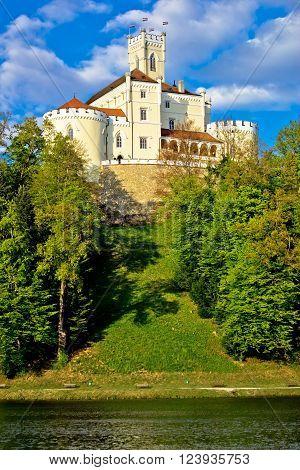 Trakoscan castle and green lake vertical view Zagorje Croatia