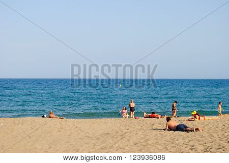 Fuengirola Costa del Sol Spain - September 13 2012 : People enjoying the sun on Fuengirola beach