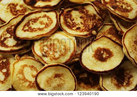 lot of rosy pancakes close up horizontal