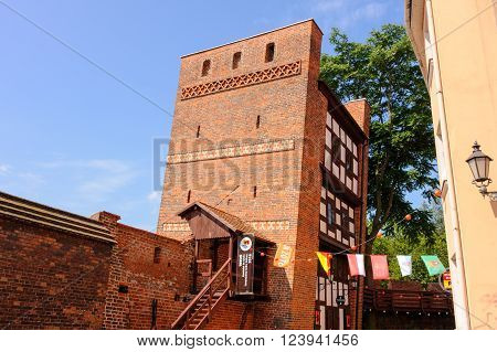 TORUN POLAND - JULY 7 2009: Medieval leaning defence tower of Torun displaced 1.5 meters as measured from the top