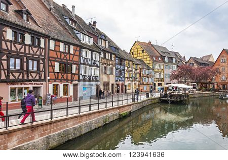 COLMAR FRANCE - MAY 2, 2013: Colourful traditional french half-timbered houses in the old town of Colmar city Alsace region France