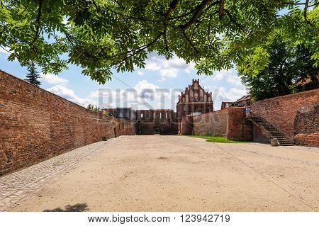 TORUN POLAND - JULY 7 2009: Gothic St. George guild house and the moat between old and new towns