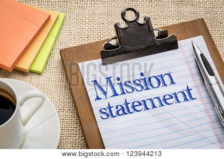 mission statement - handwriting on a clipboard with a cup of coffee