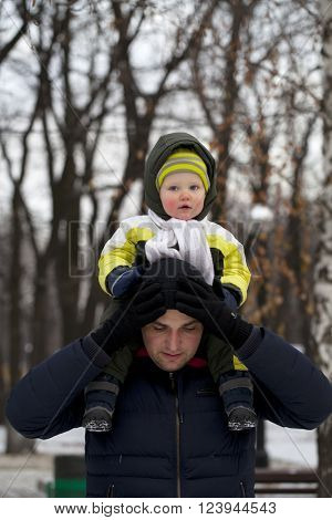 Father and son walking in the park in winter