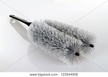 Grey Dust Brush on bright Background. Shot in studio