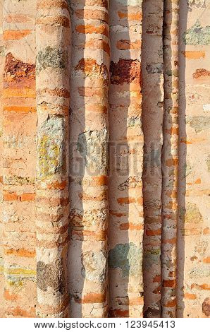 Architectural blades of ancient wall made of plinfa - thin calcined brick known as plinfa which used in Byzantium construction. Old textured architectural background.