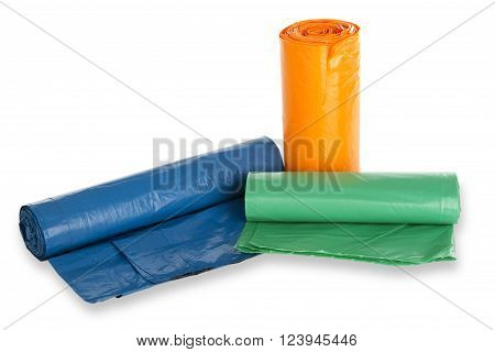 Rolls of trash bags on white background . Shot in Studio