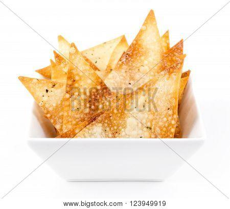 fried wonton sheet chips bowl appetizer over white