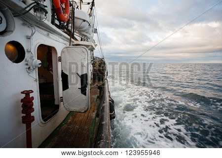 Small fishing boat floating on the sea in the early morning. Sea of Japan.