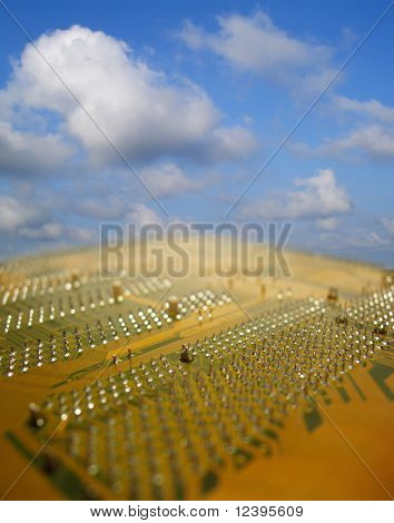 close up of circuit board against a blue sky