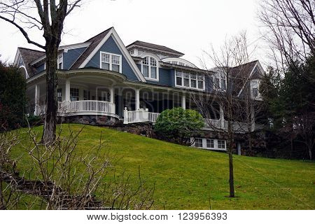 HARBOR SPRINGS, MICHIGAN / UNITED STATES - DECEMBER 23, 2015: A large lakefront mansion on top of a hill along Glenn Drive in Harbor Springs, Michigan.