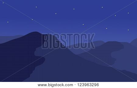 Silhouette of mountain at night with a star