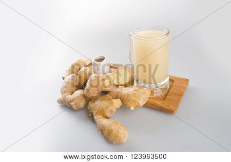 Ginger tea or fresh ginger tea on background