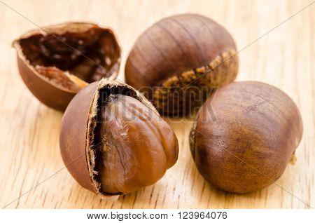 Japanese Chestnut Castanea crenata on wooden background.