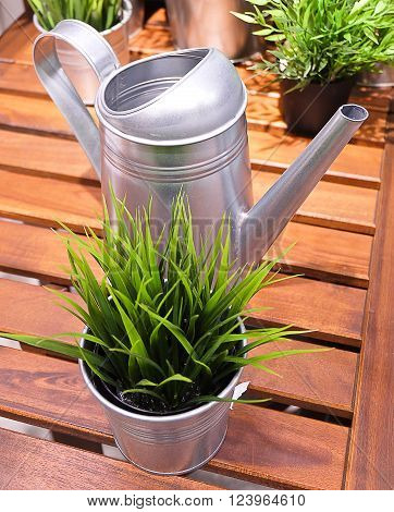 Watering Can or Watering Pot with Green Artificial Plants Watering Can Used to Water Plants by Hand.