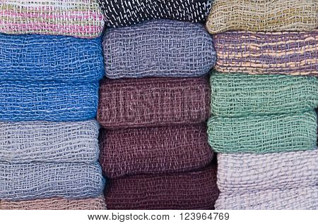 Clothing & Accessories Stack of Blanket Scarves in Different Colors.
