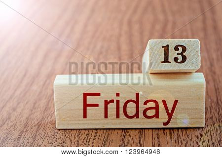 The Friday the thirteenth on wood background