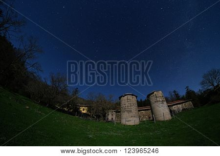 starry night on two silos of Mount Colla old homestead in Nebrodi Park, Sicily