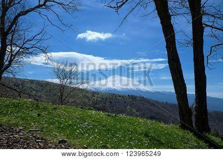 view of snowy volcano Etna from Nebrodi Park, Sicily