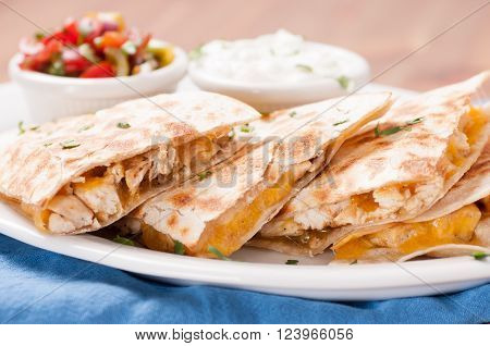 homemade quesadilla with chicken and hand made salsa plus yogurt and sour cream