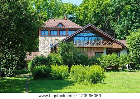 Picturesque houses between trees in Stryiskyi Park Lviv Ukraine