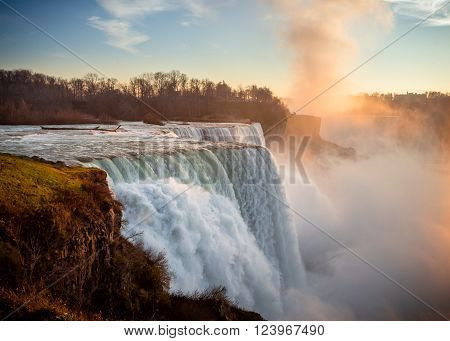 American Niagara Falls at sunset with mist rising