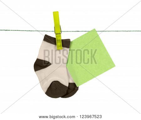 pair of children's socks hanging on clothespin