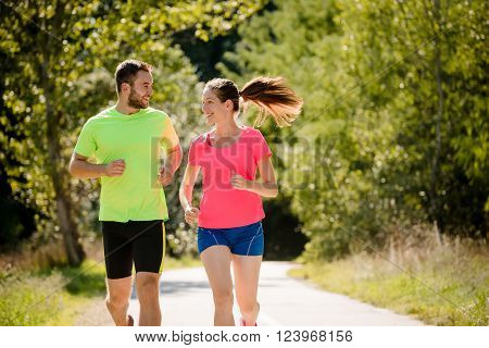 People running together and talking in summer sunny nature