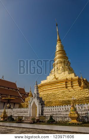 Golden Pagoda with Blue Sky, Wat Phra That Chae Hang - Nan, Thailand