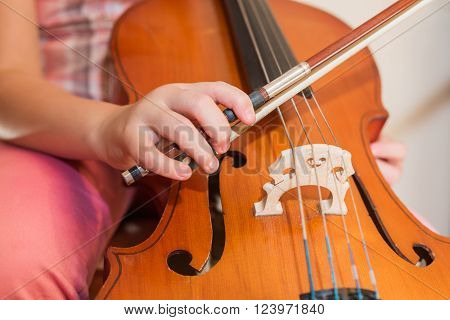 Cello instrument close up view young musician playing
