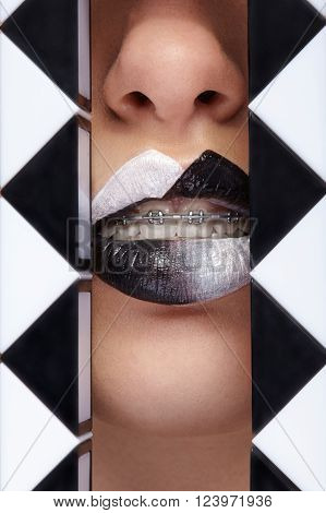 Conceptual beauty close up shot of lips arround of geometrical figures