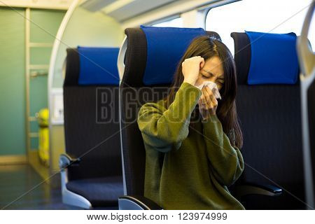 Woman feeling unwell in train compartment